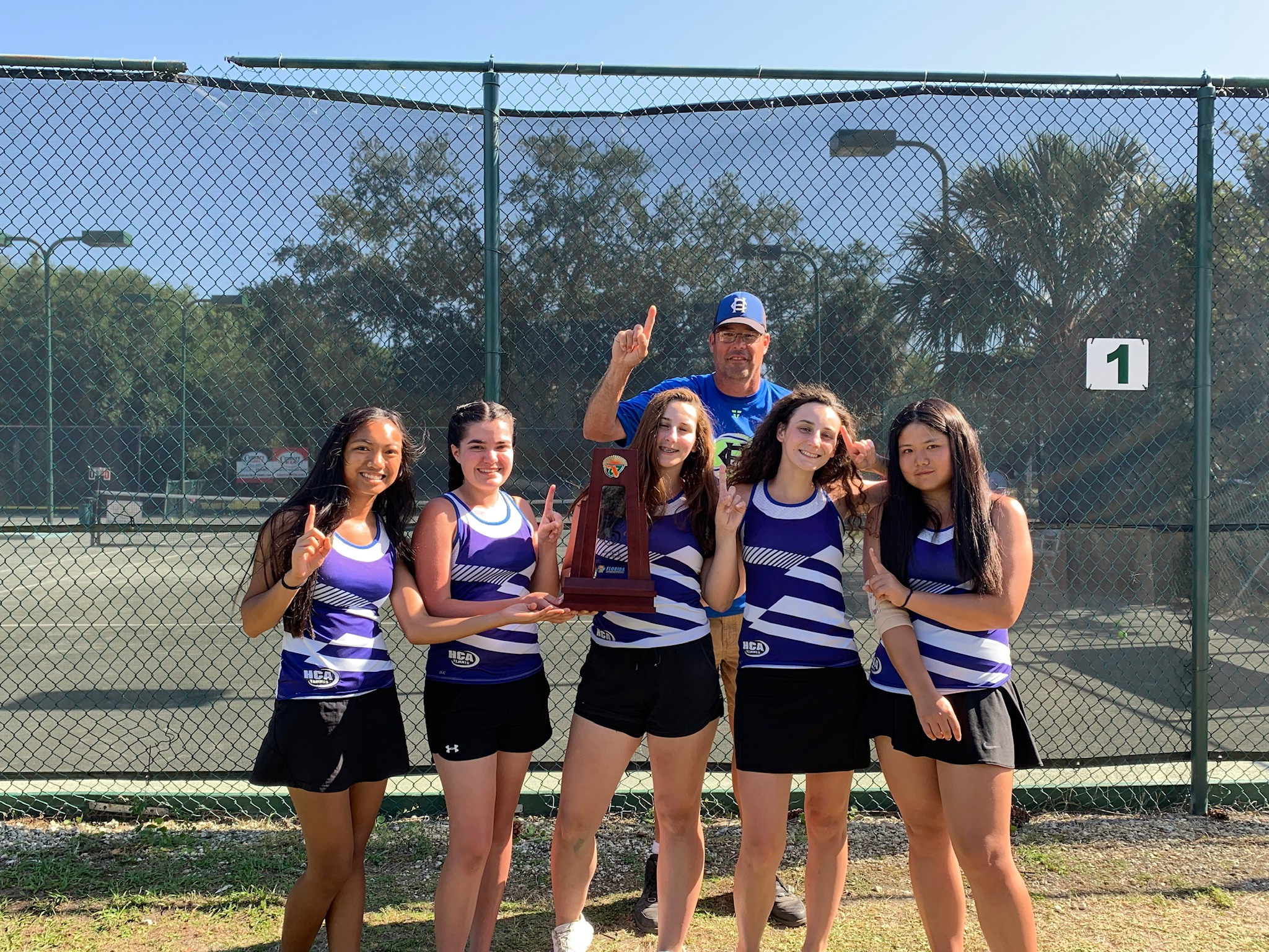 Girls' Tennis Wins District Titles!